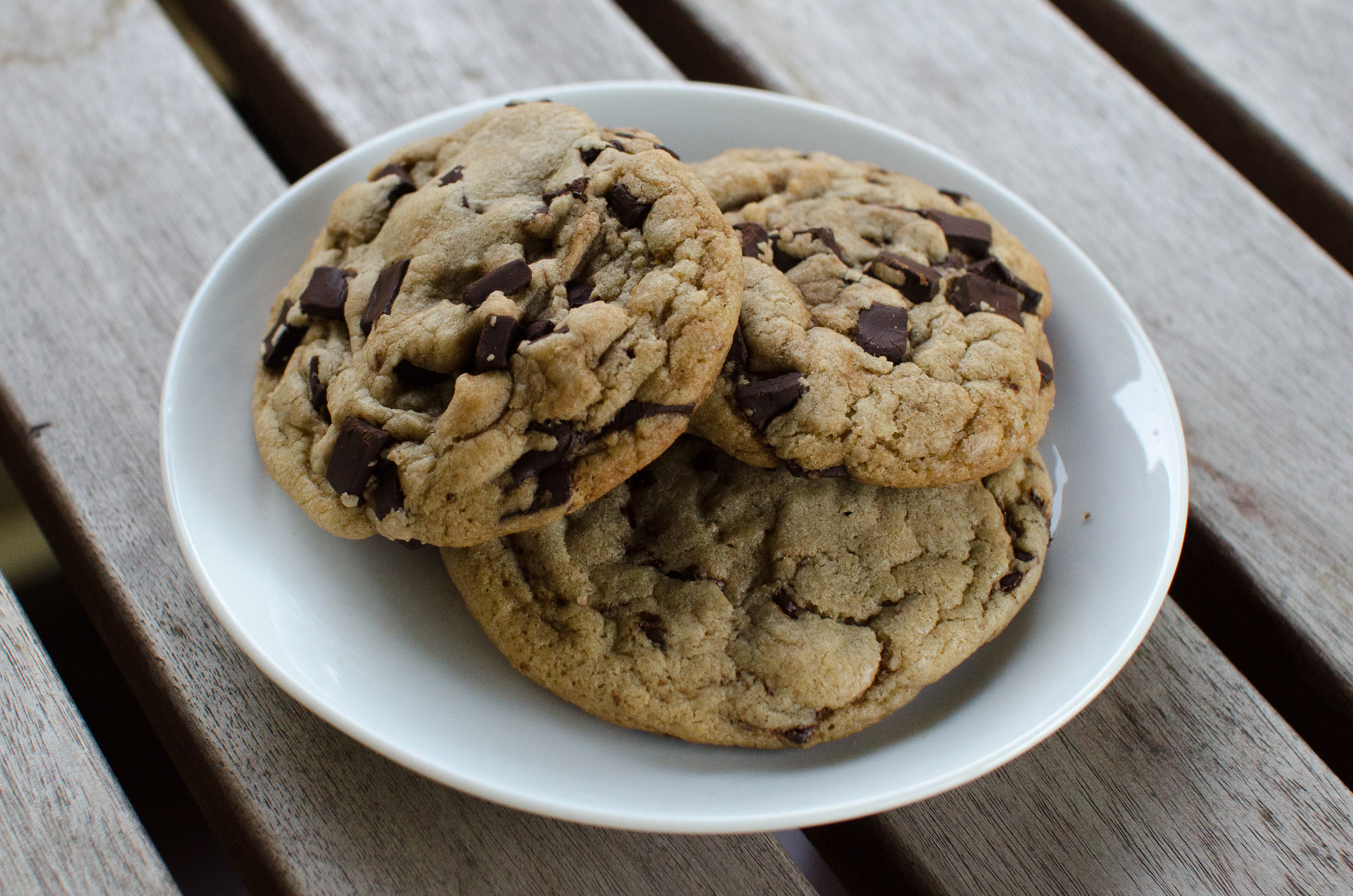 Three chocolate chip cookies on a plate.